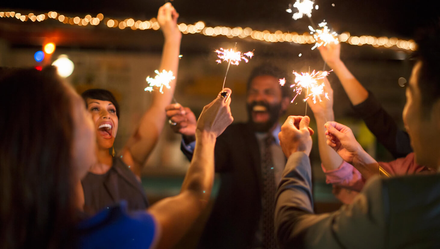 People having a celebration with sparklers