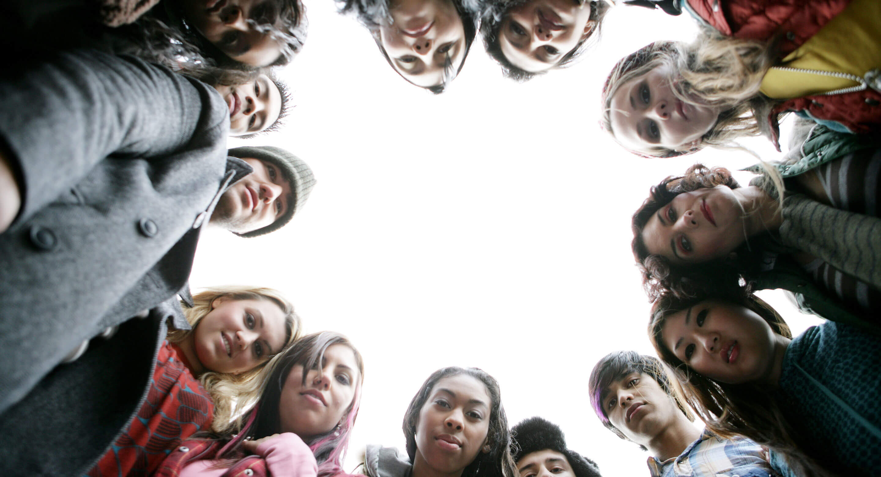 Photo of youth in a circle