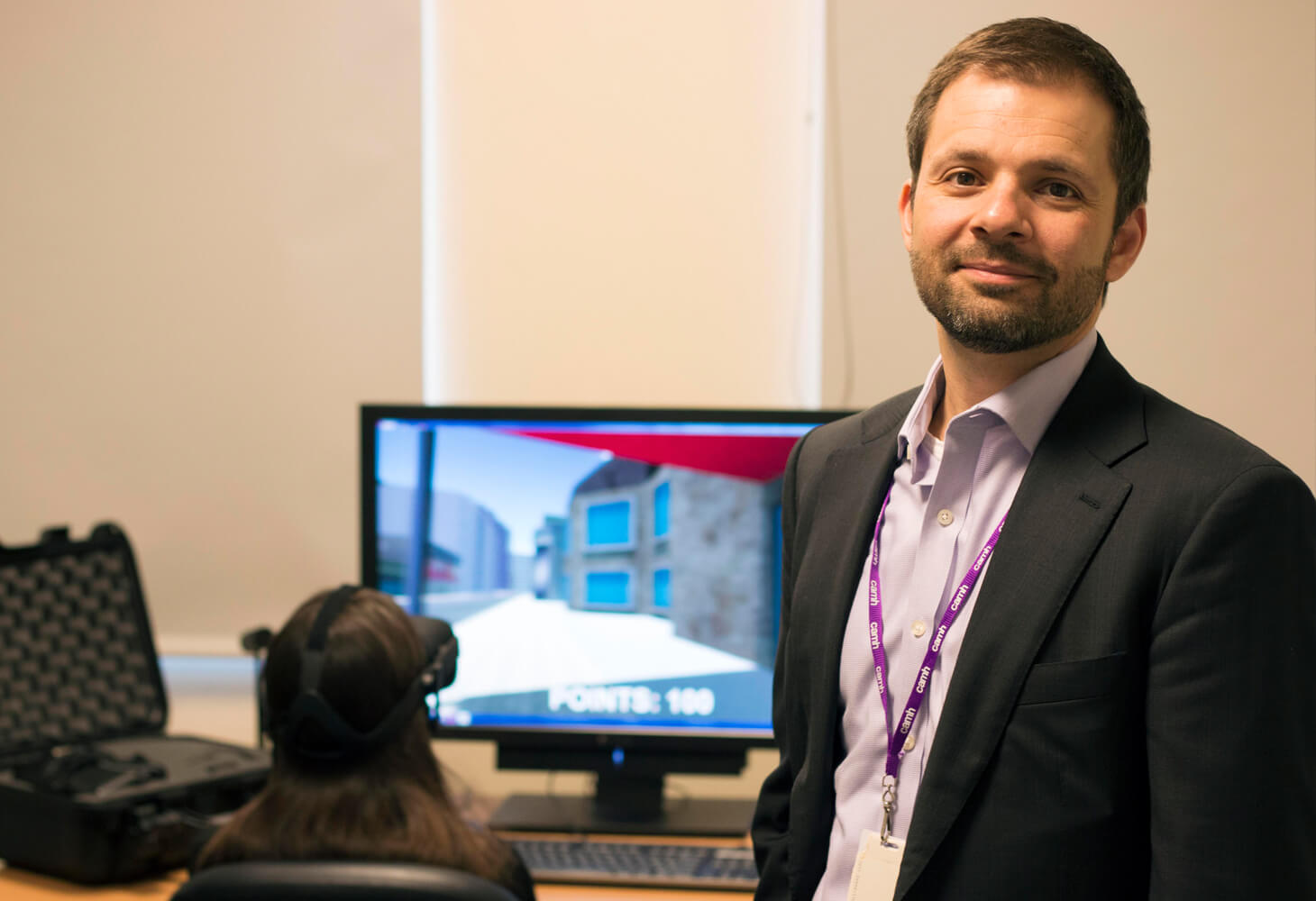 CAMH clinician standing in front of computer screen
